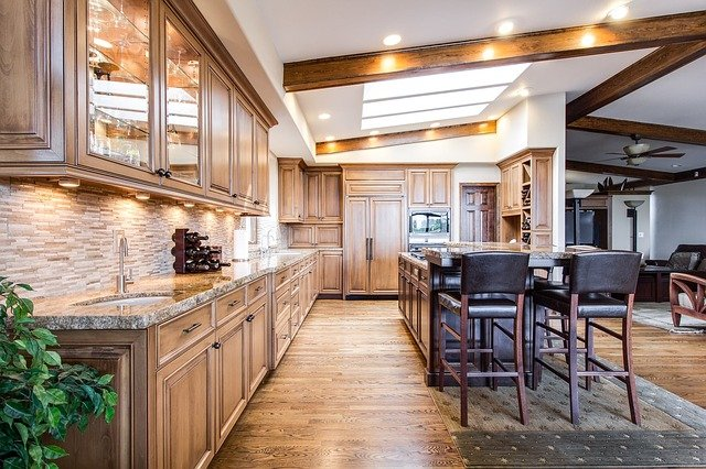A kitchen with wooden cabinets and a dining room table