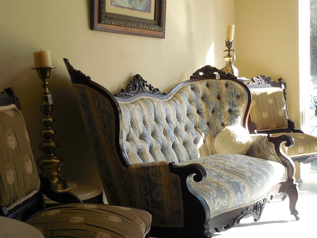 A bedroom with a bed and a chair